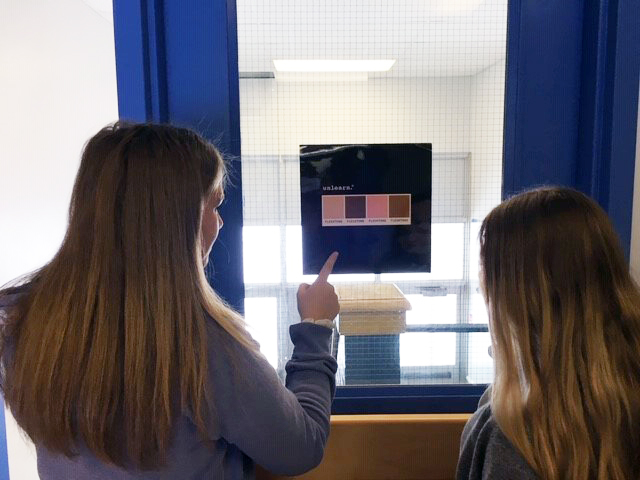 Students look at thought-provoking poster