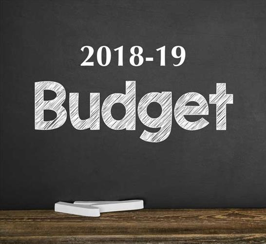 """A graphic shows the word """"budget"""" written on a chalk board"""