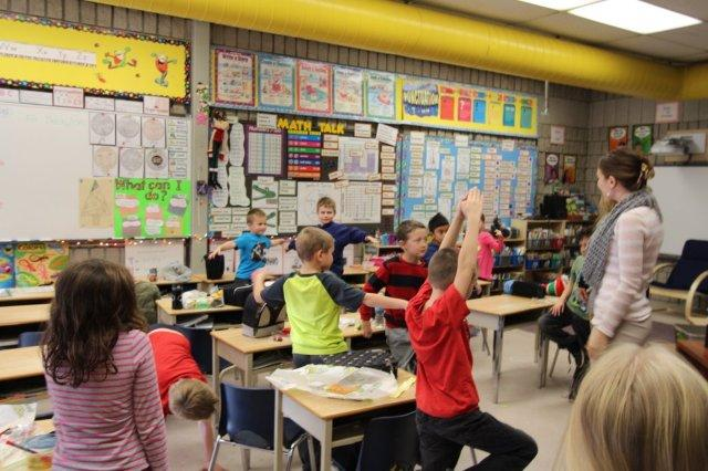 Students do yoga in the classroom