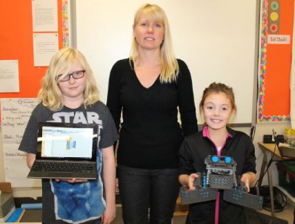 Teacher Pamela Rooney-Hofland and 2 students