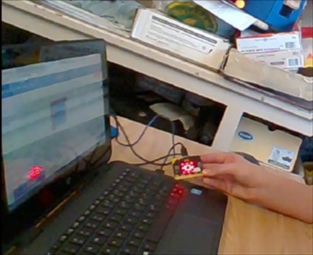 A close-up of the microbit and a laptop computer