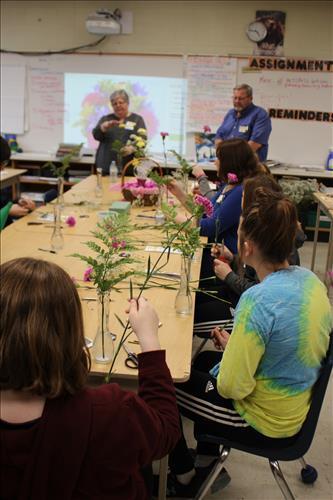 Students put together floral arrangements