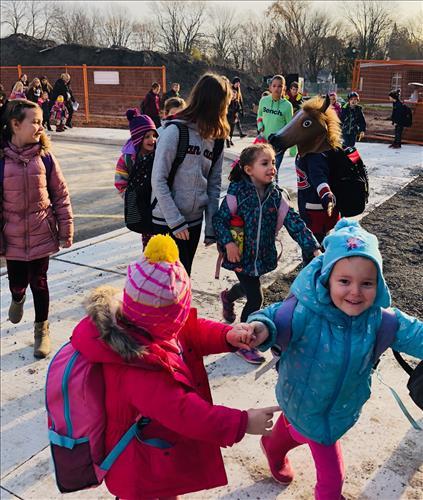 Happy students enter a new school