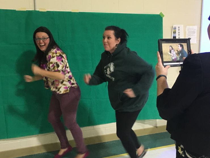 Two teachers have fun with greenscreen technology