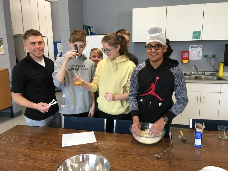 A teacher and a few students bake