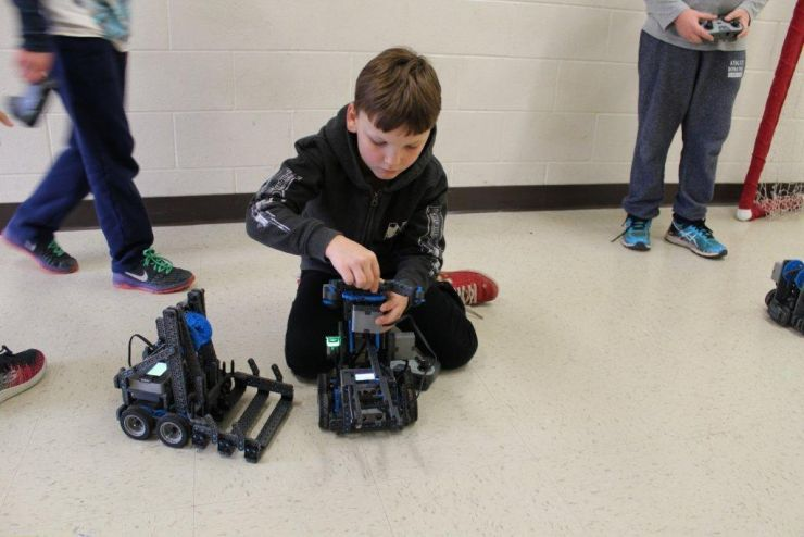 Student working with robotics, Grand Erie Ed Tech initative