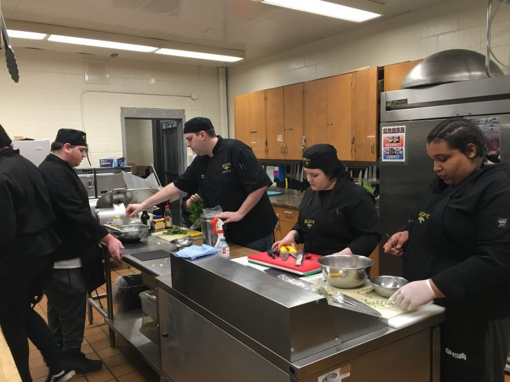 A group works in a kitchen