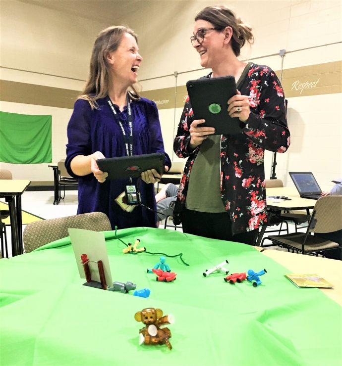 Two teachers use greenscreen technology