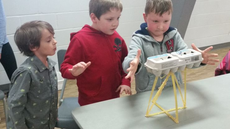 Students wait nervously to see if spaghetti structure can hold the weight