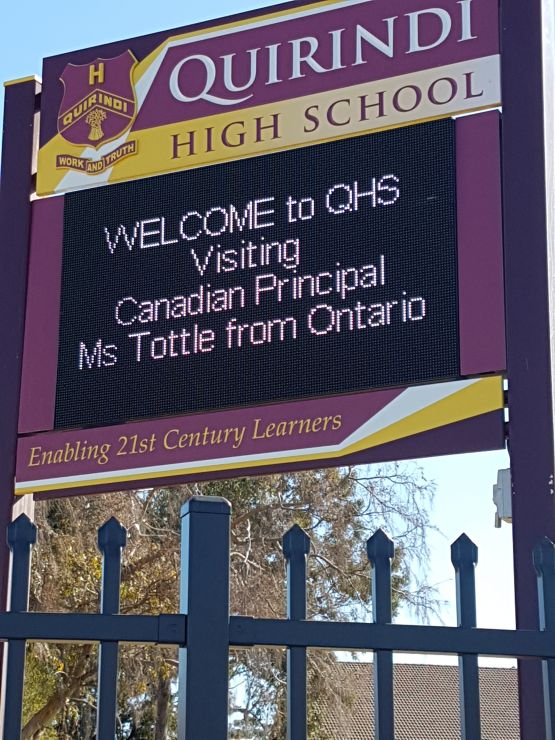 A secondary school sign display welcomes Principal Tottle