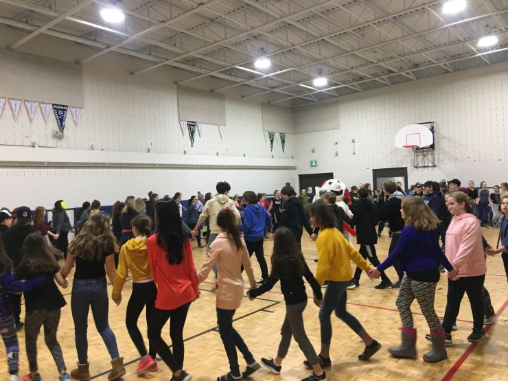 Students dance in a gym
